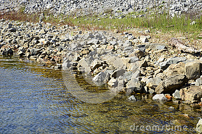 Rocky shoreline by a stream