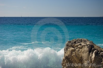 Rocs, sea and sun in the beach