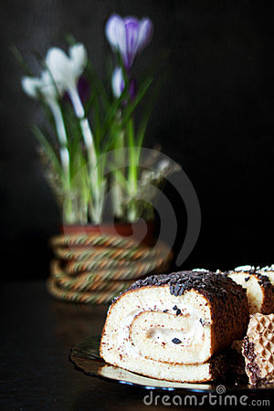 Roll cake and flowers
