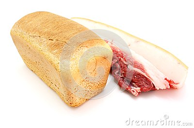 Roll of fresh bread and the big piece