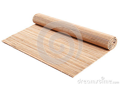 Rolled bamboo mat on white