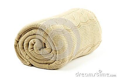 Rolled beige blanket