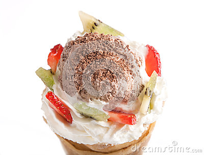 Rolled of cone pancakes with ice-cream and fruits