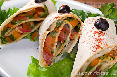 Rolled pancakes stuffed with vegetables