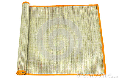 Rolled straw mat on white