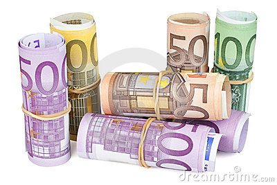 Rolled up Euro banknotes on white background