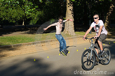 Roller and bicyclist on Hyde Park, London. Editorial Photography