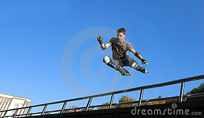 Roller boy jumping from parapet