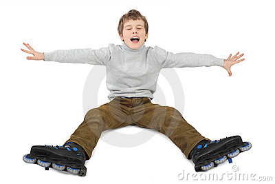 Roller boy sitting with hands at sides and crying