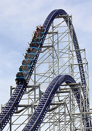 Roller coaster going up a hill