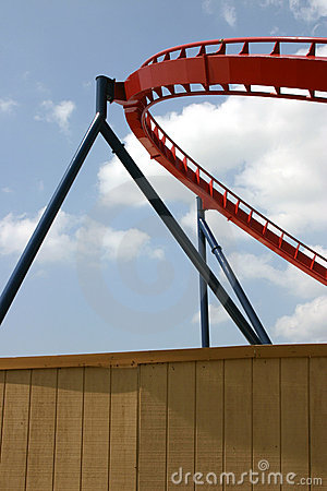 Roller Coaster segment behind wooden fence from Busch Gardens, Tampa Florida