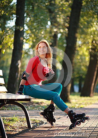 Roller sporty girl in park, woman outdoor fitness