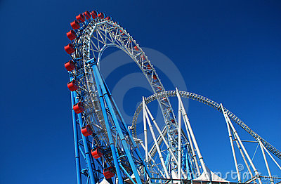 Rollercoaster amusement park against a blue sky