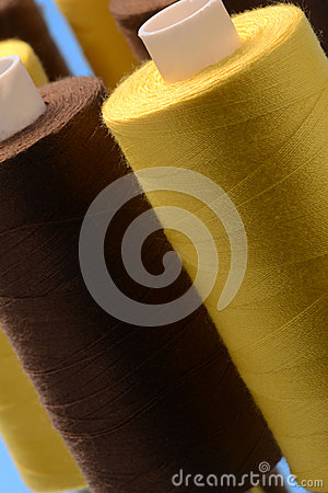 Rolls of yellow and brown cotton
