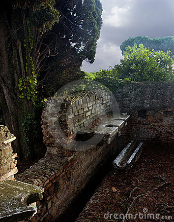Roman public latrine royalty free stock photography for Mr arredamenti ostia antica
