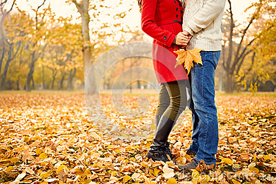 Romance in autumn in park Stock Photo