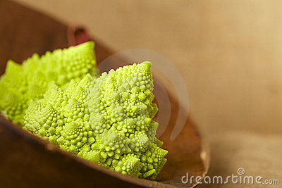 Romanesco Cauliflower broccoli in wooden bowl