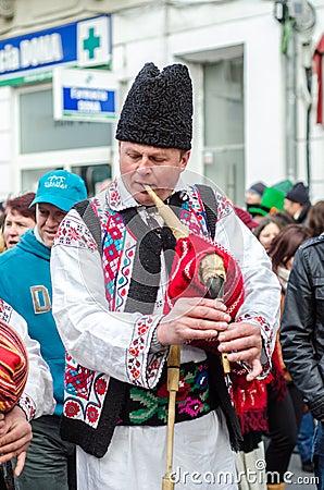 Romanian bag pipes player at Saint Patrick Parade Editorial Stock Photo