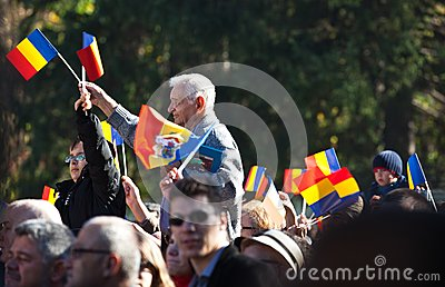 Romanian crowd waving flags Editorial Stock Image