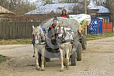 Romanian farmers on road with horse and carriage Editorial Image