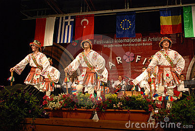 Romanian folk dancers at an international festival Editorial Image