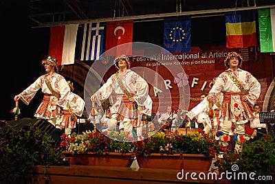 Romanian folk dancers at an international festival Editorial Image