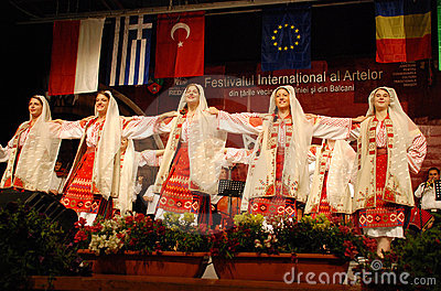 Romanian folk dancers at an international festival Editorial Photo