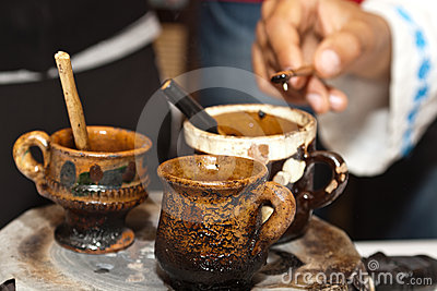 Romanian traditional clay cups with hot wax