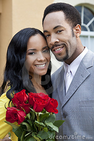 Romantic African American Couple With Roses