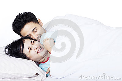 Romantic Asian couple in bed - isolated