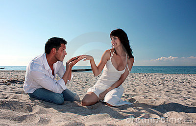 Romantic beach couple smiling