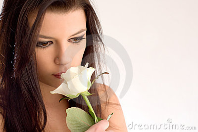 Romantic beautiful brunette with rose.