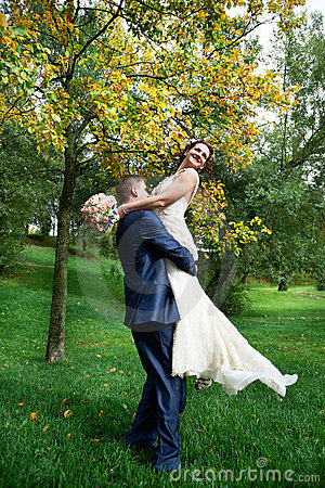 Romantic bride and groom embrace