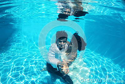 Romantic bride and groom underwater