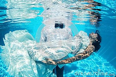 Romantic bride and groom underwater