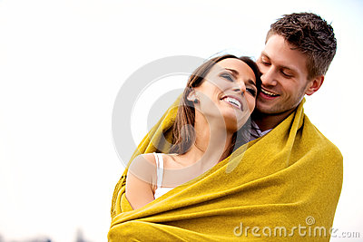 Romantic Couple with Blanket Laughing