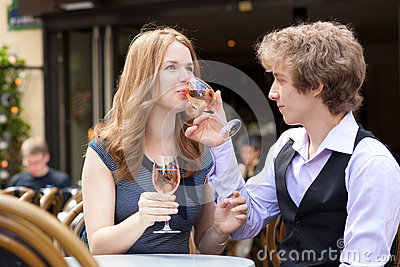 Romantic couple drinking pink wine