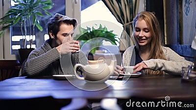 Romantic couple drinking tea at restaurant stock video footage
