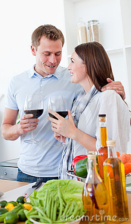 Romantic couple drinking wine while cooking