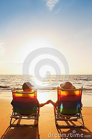Romantic Couple Enjoying Beautiful Sunset holding hands