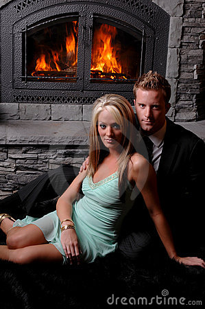 Romantic couple fireplace roaring
