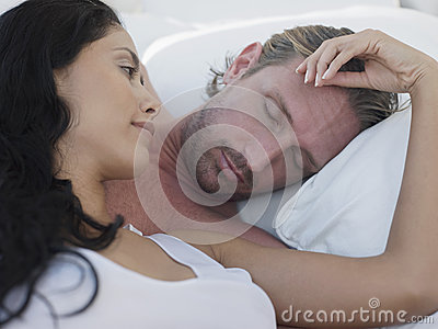 Romantic Couple In Four-Poster Bed