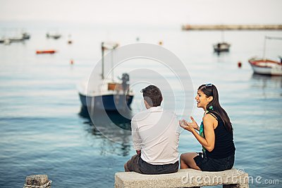 Romantic couple having relationship problems.Woman crying and begging a man.Fisherman life,dangerous occupation.Navy sailors Stock Photo