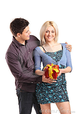 A romantic couple holding a gift