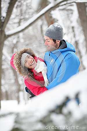 Romantic couple hugging in the snow