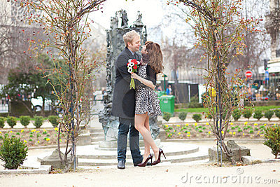 Romantic couple hugging under an arch