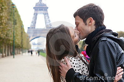 Romantic couple kissing near the Eiffel Tower