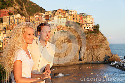 Romantic couple in love by sunset in Cinque Terre