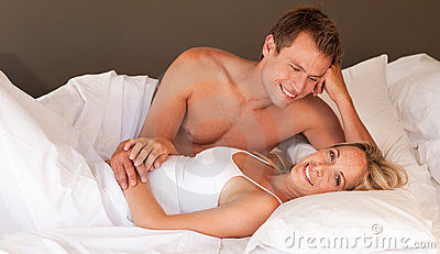 Romantic couple lying on a bed