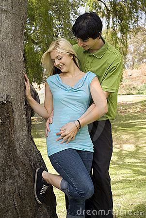 Romantic couple next to garden tree